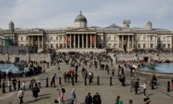 DescriptionTourists at Trafalgar Square, London, England, UK